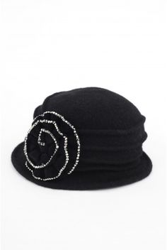 Type 4 Vintage Vogue Hat     Borrow a look from the glamorous past and bring it up to date with this vintage inspired black felted wool hat.        100% Wool      23 inch band, circumference