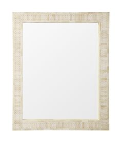 Antique white bone tiles give this simple design a rich polished texture. Handcrafted following the ancient artistry of bone inlay, tiles are held together with white resin and detailed with decorative nailheads.