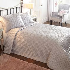 Grace Silver Bedspread | Our exclusive Grace range takes the current trend for soft shades and complements it perfectly with intricately embroidered pastel flowers. The bedspread is crafted from the softest sateen fabric and are filled with polyester. It also has a soft microfibre reverse, also made from polyester. #Kaleidoscope #Home #Bloggers #Bedroom #Bedding #Style #Homewares www.kaleidoscope.co.uk