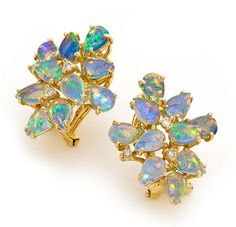 Earrings with ten pear- shaped Coober Pedy Opals each, in 14k yellow gold with round cut diamonds. #opalsaustralia