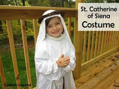 My little Naomi, had the hardest time deciding who to dress as for All Saints day. I was very surprised when she finally decided on St. Cat...