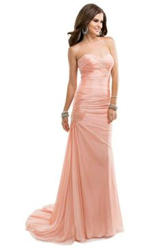 We just love the trendy lace applique softly bedazzled with rhinestones! The body-hugging silhouette doesn't hurt, either.   Flirt #flirtprom #promdress #blush #pink