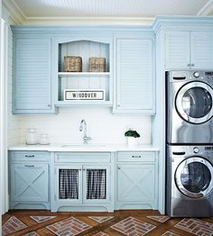 Blue laundry room features a beadboard ceiling over blue louvered upper cabinets and blue x trim lower cabinets paired with white quartz countertops and a shiplap backsplash.