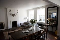 This mans NO FUSS home in a converted pub is right on. Mat Collishaw, living and dining room, dark wood floors, Camberwell, London Cost Of Laminate Flooring, Fake Wood Flooring, Cheap Vinyl Flooring, Dark Wood Floors, Man Cave Flooring Ideas, Hudson Homes, Camberwell London, Living Spaces, Interior Design