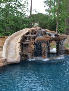 Inground Pools With Waterfalls And Slides slides with stone waterfall for inground pools | rock waterfalls