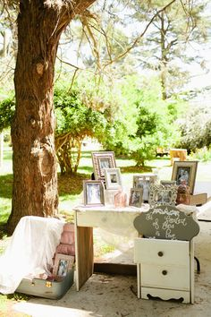 Vintage Wedding Decor. --I love all the different photo frames with different photos of the couple over time.