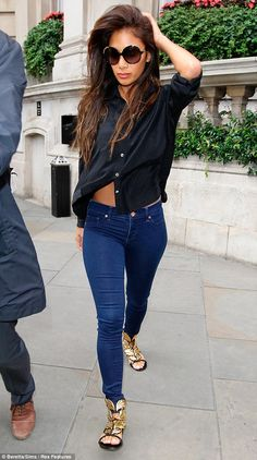 Nicole Scherzinger glams up skinny jeans and a loose black shirt with statement Giuseppe Zanotti gold leaf flat sandals and oversized sunglasses. via dailymail.co.uk