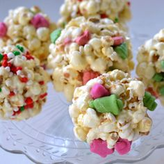 Popcorn Balls | SimplyCelebrate.Meals.com - Wonka candies bring the Christmas spirit to these treats. Wrap up these yummy popcorn balls for cute gifts! #christmas #simplycelebrate