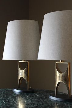 A sculptural pair of 1960s brass lamps in Lighting