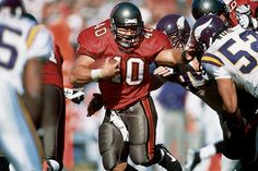 Take your pic between Alstott, San Francisco's Tom Rathman, Dallas' Daryl Johnston and others as the prototypical short-yardage fullback. Alstott made a career crushing defenders near the line of srimmage, and he still managed to chalk up more than 5,000 career yards, one of the top 25 power running backs of all time. (Photo: Damian Strohmeyer/SI)