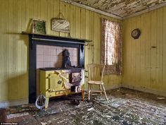The kitchen in a cottage on the Isle of Harris remains a cheerful shade of yellow - a cloc...