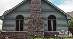 Dress up casement windows with a half-circle above. Shown with internal custom grid. #homedesign #homeimprovement
