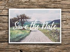 Weve paired a vintage image of a winding country road with bohemian-inspired typography to create a perfect save the date postcard for your wedding!