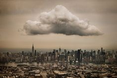 "Midtown Cloud ""I snapped this from the window seat as my plane was approaching LaGuardia Airport. The cloud is over Manhattan, while Brooklyn and Queens are visibile in the foreground, separated by Newtown Creek."" Captured by Jeff Weston"