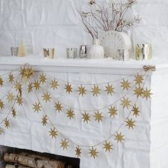 Glitter Kraft Gold Star Garland | west elm -- Must get this for the mantle this year!