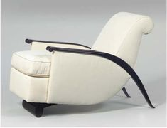 """gonse"" armchair, 1930-1932. Lacquered wood, fabric. Underside of one frame branded with ""Ruhlmann""."