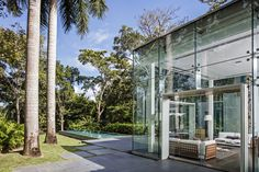 The home of Puerto Rico's leading luxury residential developer is a fitting gem on the Caribbean coast. Hot House, Glass Boxes, Puerto Ricans, Open Up, Windows And Doors, Caribbean, Beach House, The Originals, Luxury