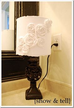 Lamp shade covered in white cotton and flowers made from the same cotton glued on....