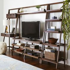 Our ladder-style TV stand provides lots of space for your electronics. Handcrafted of pine and engineered wood for durability and strength, Morgan is finished with hand-rubbed color for a lightly distressed effect and offers a clean, contemporary silhouette. Time to take a stand for your TV.