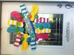 Celebrate summer with all materials from the Dollar Tree and hot glued to an old wreath.