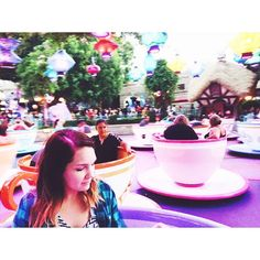 This is Emily. She turned old today. But in the best way.  Emily is one of the most creative humans I know. She lives life vibrantly out of love. She also makes sitting in a tea cup look good.  Happy Birthday Em!  #disneylandwithdrawals by nataleezyy