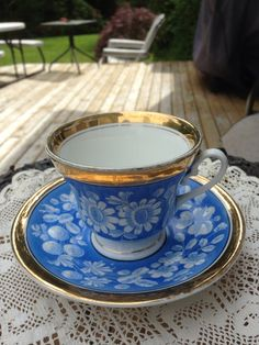 Vintage Blue and White Floral Teacup and Saucer Gold Gilt Trim flowers