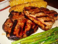 Grilled apricot pork chops with asparagus and corn.  Simply elegant.