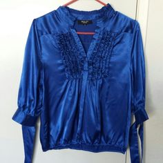 Beautiful royal blue satin top Gorgeous satin top that ties at the sleeves. Very elegant and comfy to wear. Perfect for a night out. It is in excellent condition. Fabric feels ver soft against the skin. Tops
