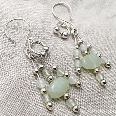 A flirty and fun take on tassel earrings in serpentine gemstones and sterling silver for you today! Soft and gentle spring colour to frame your face with sparkle and shine. Have a peek in the shop to see what else is new for spring! Tassel Earrings, Gemstone Earrings, Sterling Silver Earrings, Dangle Earrings, Jade Bracelet, Green Gemstones, Artisan Jewelry, Wire Jewelry, Earrings Handmade