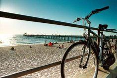 Bike riding along a beach...perfect.
