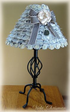 Here's a lampshade Vicki altered using the ad pages that will be on CD #3 and simply punching out circles and layering them starting from the bottom. You can get details on her blog.