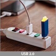ThinkGeek :: USB Power Strip.  A couple of these at the entry and the family can charge EVERYTHING daily without arguing!