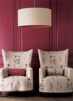 Boldly modern + traditional: Pink living room + feminine floral + wing chairs