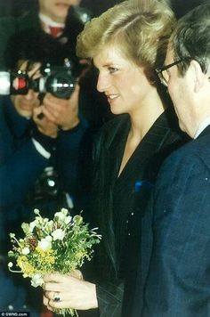 Diana, Princess of Wales, receiving a posy of flowers in London in 1988