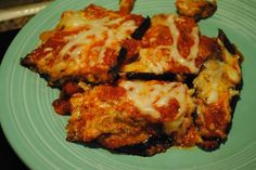 Roasted Eggplant Parmesan  Ingredients:  2 medium eggplants (about 2 pounds)  1 tablespoons salt  2 tablespoons olive oil  1 cup ricotta cheese  ¾ cup mozzarella (divided)  1 tablespoon chopped parsley  1 tablespoon chopped basil  1½ cups marinara sauce (divided)  2 tablespoons parmesan chees