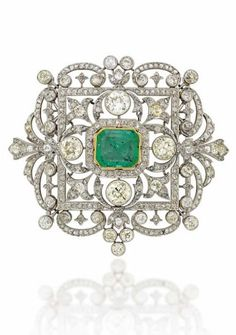 Early 20th century emerald and diamond brooch by Garrard