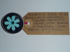 Pillsbury's Pieces No, 203. Pin with black capsule with turquoise flower. In exchange for a donation to KATHMANDU ANIMAL TREATMENT CENTRE, Nepal. Available at St. George's Church, Madrid on Saturday 13 June from 11.00 - 15.00.