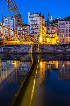 France, Lyon, Quai Saint-Vincent reflections by night