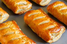 Pork Sausage Rolls in Puff Pastry by DPimborough. Freshly baked sausage rolls made with puff pastry fresh out of the oven cooling on a tray Vegan Sausage Rolls, Vegan Magazine, Stilton Cheese, Grilled Sausage, Baked Sausage, Sausage Seasoning, Buffet, Vegan Wine, Why Vegan