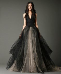 Vera Wang   Black silk georgette and silk faille V-neck halter ballgown with hand-pieced Chantilly lace appliqué and multi-layered, crushed and honey comb tulle skirt