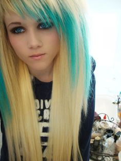 Blonde hair with turquoise streaks and I actually like this haircut!!! Kind of.. Idk