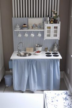 Play kitchen inspiration looking at this I can go to lowes and recreate this :) it's adorable and would be something special for any kid to play with