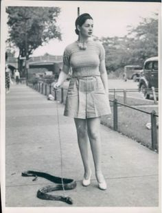 burlesque dancer, zorita, walks her pet snake   I love this, even though I don't tend to use a leash on any of my reptiles, except Jack (my very muscley leo)