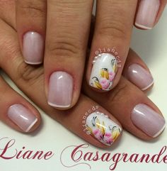 White French tips and floral designs. Add pretty flora designs with your French tips to make your nails look classy yet endearing at the same time.
