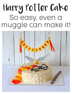Easy to Make Harry Potter Birthday Cake - scarf is made from fruit roll-up, wand is a chocolate covered pretzel rod, golden snitch is a Ferrero Rocher candy with cut-out paper wings.  And the Gryffindor Cake topper is the BEST!