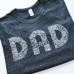"""PLEASE NOTE: These tees are more of a fitted style tee + men may prefer to size up one. """"Dad: A son's first superhero and a daughter's first love"""" Struggling to find the perfect gift for that wonderfu"""