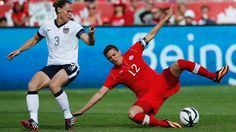 Christie Rampone and Christine Sinclair, June 2, 2013. (Mark Blinch/Reuters)