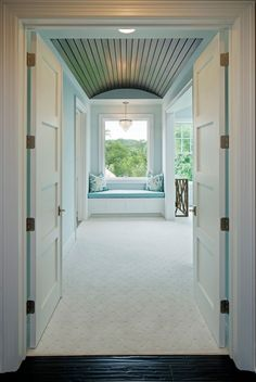 Master Bedroom Door, Double doors open to a master bedroom with barrel ceiling and window seat #Masterbedroom #barrelceiling #windowseat Grace Hill Design