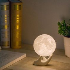 Turn off those harsh overhead lights and wind down at night the way nature intended - under the soothing light of the moon. This 3D printed photorealistic moon lamp is sure to bring romance to any room.<br>  <li>Made with 3D printing technology <li>Eco-friendly material <li>Adjustable brightness <li>USB powered with internal battery <li>Includes a light stand