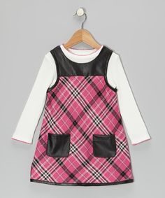The faux leather on this dress is just the thing to complement its peppy pink plaid print. A versatile tee underneath is great with this piece or any other jumper! Includes top and dressTop: 60% cotton / 40% polyesterDress: 99% polyester / 1% LurexMachine wash; tumble dryImported